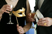 A Masquerade ball on Board the Aurora cruise ship. - Paul Box - 2000s,2004,AFFLUENCE,AFFLUENT,alcohol,ball,Bourgeoisie,CHAMPAGNE,champaign,cruise,drink,drinker,drinkers,drinking,drinks,elite,elitism,EQUALITY,FEMALE,high,high income,holiday,holiday maker,holiday ma