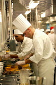 The Aurora cruise ship, a P&O cruise ship. An Indonesian chef at work in the kitchen.. - Paul Box - 02-06-2004