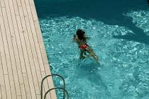 The Aurora cruise ship, a P&O cruise ship. Guests enjoy the swimming pool. - Paul Box - 02-06-2004