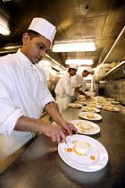 The Aurora cruise ship, a P&O cruise ship. Indonesian chefs prepare food. - Paul Box - 02-06-2004