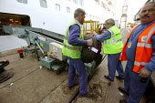 The Aurora cruise ship, a P&O cruise ship. Baggauge handlers load guests suitcases. - Paul Box - 02-06-2004