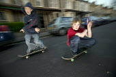 Boys skateboard in the street, Bristol. - Paul Box - ,2000s,2004,adolescence,adolescent,adolescents,boy,boys,child,CHILDHOOD,children,EXTREME,highway,hobbies,hobby,hobbyist,in,jump,jumping,juvenile,juveniles,kid,kids,LFL leisure,male,people,person,perso