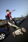 Boys skateboard in the street, Bristol. - Paul Box - 2000s,2004,adolescence,adolescent,adolescents,boy,boys,child,CHILDHOOD,children,EXTREME,highway,hobbies,hobby,hobbyist,in,jump,jumping,juvenile,juveniles,kid,kids,LFL leisure,male,people,person,person