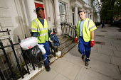 Dustbin workers on the streets of Kensington, London - Paul Box - 2000s,2004,bag,bags,BAME,BAMEs,bin,bin man,bin man binmen,bin men,binman,binmen,bins,black,BME,bmes,cities,city,collecting,collection,collector,Council Services,council service,Council Services,cultur