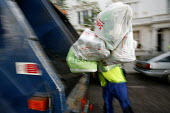 Dustbin workers on the streets of Kensington, London - Paul Box - 2000s,2004,bag,bags,BAME,BAMEs,bin,bin man,bin man binmen,bin men,binman,binmen,bins,black,BME,bmes,cities,city,collecting,collection,collector,Council Services,council service,Council Services,divers
