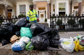 Dustbin workers on the streets of Kensington, London - Paul Box - ,2000s,2004,bag,bags,BAME,BAMEs,bin,bin man,bin man binmen,bin men,binman,binmen,bins,black,BME,bmes,cities,city,collecting,collection,collector,Council Services,council service,Council Services,diver