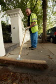 Road sweeper on the streets of Kensington, London - Paul Box - 07-07-2004
