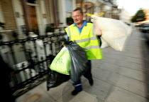 Dustbin workers on the streets of Kensington, London - Paul Box - 2000s,2004,bag,bags,bin,bin man,bin man binmen,bin men,binman,binmen,bins,black,cities,city,collecting,collection,collector,Council Services,council service,Council Services,domestic,dustbin,DUSTBINS,