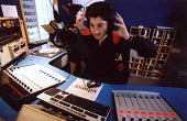 A teenager sitts in a studio at a local radio station for work experience. - Paul Box - 05-09-2004