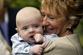 A baby with his grandmother. - Paul Box - 28-11-2004