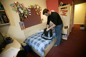 A student in his bedroom. The University of Bath. - Paul Box - 2000s,2004,accommodation,bedroom,BEDROOMS,EDU Education,halls,Higher Education,housing,LFL Lifestyle leisure,life,male,modern,of,rented,residence,room,rooms,student,students,university