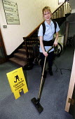 A cleaner at work vacuuming the floor carpet at the Nuffield Hospital, a private hospital, Bristol. - Paul Box - 01-11-2004