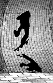 A skateboarder in the city centre. - Paul Box - 2000s,2004,boarder,cities,city,culture,EXTREME,hobbies,hobby,hobbyist,LFL Lifestyle leisure,life,pavement,scene,scenes,shadow,sidewalk,skate,skateboard,skateboarder,skateboarders,skateboarding,SKATEBO