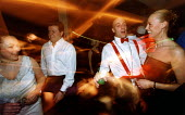 Office workers dance at their christmas party. - Paul Box - 01-11-2004