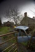 A run down farm in North Wales. - Paul Box - ,2000s,2005,abandoned,AGRICULTURAL,agriculture,building,buildings,capitalism,capitalist,derelict,DERELICTION,dilapidated,down,EBF Economy,EQUALITY,excluded,exclusion,farm,farmed,farming,farmyard,farmy