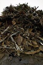 A pile of scrap metal at Scrap yard in North wales - Paul Box - 2000s,2005,AUTO,AUTOMOBILE,AUTOMOBILES,AUTOMOTIVE,breaker,breakers,capitalism,capitalist,car,CARS,consummer,EBF Economy,ENI Environmental issues,Industries,industry,junkyard,maker,makers,making,metal,
