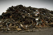 A pile of scrap metal at Scrap yard in North wales - Paul Box - 2000s,2005,AUTO,AUTOMOBILE,AUTOMOBILES,AUTOMOTIVE,breaker,breakers,capitalism,capitalist,car,CARS,consummer,EBF Economy,ENI Environmental issues,industrial,Industries,industry,junkyard,maker,makers,ma