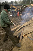 Worker at Scrap yard in North wales, cutting metal plates - Paul Box - 20-03-2005