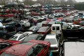 A Car scrap yard, car breakers yard in North wales - Paul Box - 2000s,2005,accident,accidental,ACCIDENTS,AUTO,AUTOMOBILE,AUTOMOBILES,AUTOMOTIVE,breaker,breakers,c,capitalism,capitalist,car,cars,crashed,damaged,dirty,EBF Economy,eni environmental issue,Industries,i