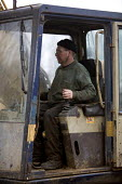 Worker at a Scrap yard in North wales driving the grabber - Paul Box - 20-03-2005