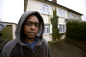 A resident outside condemmed home. Council Houses in Filton, Bristol. They were built in the 1950s and are suffering from concrete decay due to Alkali Silica reaction. They are being demolished and th... - Paul Box - 1950's,2000s,2005,accommodation,affordable,bad,black,BME Black minority ethnic,cheap,cities,City,communities,community,concrete,condemed,cost,Council,council estate,council services,council estate,cou