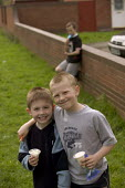 Kids eating ice cream Weston Super Mare - Paul Box - 2000s,2005,at,boy,boys,child,CHILDHOOD,children,council estate,council services,council estate,council services,eating,EQUALITY,excluded,exclusion,food,FOODS,friend,friends,friendship,friendships,HARD