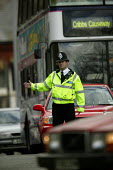 A police man directs the traffic in Bristol at the visit of Charles Kennedy. - Paul Box - 2000s,2005,adult,adults,AUTO,AUTOMOBILE,AUTOMOBILES,AUTOMOTIVE,beat,car,cars,cities,city,CLJ,CLJ crime law,duty,force,high,high visibility,highly,highway,jackets,male,man,MATURE,men,officer,officers,o