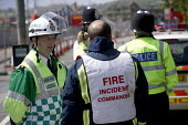 Fire incident commander at a gas leak incident in bristol. Talks to the ambulance incident commander. - Paul Box - 25-04-2005