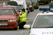 A police officer talks to a motorist at a gas leak incident in bristol. - Paul Box - 25-04-2005