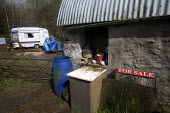 Produce stall. Derelict farm buildings in an area of rural poverty in south west Wales - Paul Box - 20-04-2005