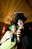 A couple enjoying a pint of Guinness on St Patricks day in a bar in Swansea - Paul Box - 18-03-2005
