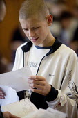 Clevedon school, pupils getting their GCSE results. A concerned student looks over his exam results. - Paul Box - 25-08-2005