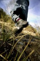 A walker hikes across a muddy footpath.. - Paul Box - 10-12-2005