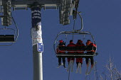 Skiers on a ski lift in Sainte Foy nr Tignes and Val Diser in the French alps. - Paul Box - 05-12-2005