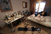 A messy chalet, Sainte Foy nr Tignes and Val Diser in the French alps. - Paul Box - 2000s,2005,accommodation,after,alcohol,asleep,beer,before,bottle,bottles,chalet,drink,drinking,drinks,empty,eu,Europe,european,europeans,exhausted,EXHAUSTION,french,hangover,holiday,holiday maker,holi