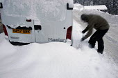 A vehicle covered in snow, Sainte Foy nr Tignes and Val Diser in the French alps. - Paul Box - 2000s,2005,a,AUTO,AUTOMOBILE,AUTOMOBILES,AUTOMOTIVE,car,CARS,coverd,covered,digging,drift,DRIVER,DRIVERS,driving,eu,Europe,european,europeans,fall,french,fresh,heavy,holiday,holiday maker,holiday make
