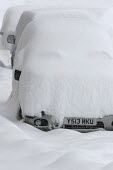 A vehicle covered in snow, Sainte Foy nr Tignes and Val Diser in the French alps. - Paul Box - 2000s,2005,AUTO,AUTOMOBILE,AUTOMOBILES,AUTOMOTIVE,car,cars,coverd,covered,drift,DRIVER,DRIVERS,driving,eu,Europe,european,europeans,fall,french,fresh,heavy,in,landscape,LANDSCAPES,LFL Lifestyle leisur