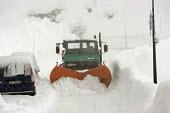 After a heavy snowfall a snow plough clears the road, Sainte Foy nr Tignes and Val Diser in the French alps. - Paul Box - ,2000s,2005,chalets,covered,drift,DRIVER,DRIVERS,driving,eu,Europe,european,europeans,fall,french,fresh,heavy,highway,in,job,jobs,LAB LBR work,landscape,LANDSCAPES,LFL Lifestyle leisure,mountain,mount