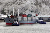 A cargo ship docks at Dover with the help of 2 tug boats. - Paul Box - 05-12-2005