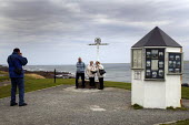 Elderly tourists pose for a photograph at John O Groats, the most northerly point of the UK, Scotland - Paul Box - 05-12-2005