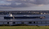 Oil Tanker docks at Milford Haven, Pembrokeshire - Paul Box - 2000s,2005,at,BOAT,boats,capitalism,capitalist,chemical industry,chemicalindustry,coast,coastal,coasts,dock,docks,EBF Economy,ENI Environmental issues,harbor,harbors,harbour,harbours,import,IMPORTED,i