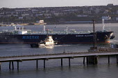 Oil Tanker docks at Milford Haven, Pembrokeshire - Paul Box - 2000s,2005,at,BOAT,boats,capitalism,capitalist,chemical industry,chemicalindustry,coast,coastal,coasts,dock,docks,EBF Economy,ENI Environmental issues,export,exports,harbor,harbors,harbour,harbours,im
