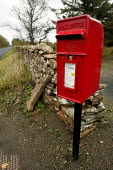 A post box and very small post office in the countryside, Mey, Scotland. - Paul Box - 2000s,2005,box,boxes,country,countryside,EBF Economy,hut,in,MAIL,outdoors,outside,pillar,post,Post Office,post box,post boxes,Post Office,Postal Service,postbox,postboxes,public services,red,ROYAL,rur