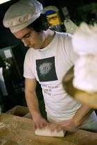 The head baker Kneeds bread dough , Hobbs house bakery, nr Bristol. - Paul Box - 05-12-2005