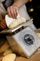 The head baker weighs bread dough , Hobbs house bakery, nr Bristol. - Paul Box - 05-12-2005