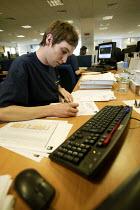 An office worker from Axa Sunlife hard at work. - Paul Box - 05-12-2005