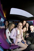 A teenage girl and her mates hire a limo , Bristol. - Paul Box - 2000s,2005,adolescence,adolescent,adolescents,cities,city,female,females,for,friend,friends,friendship,friendships,GIRL,girls,hire,in,LFL Lifestyle leisure,limousine,limousines,PEOPLE,person,persons,t