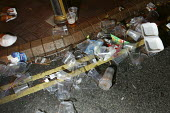 Full litter bin in the street after Cowes week. - Paul Box - ,2000s,2005,alcohol,anti social behaviour,at,behavior,behaviour,bins,drink,drinking,drinks,eni,environment,Environmental Issues,holiday,holiday maker,holiday makers,holidaymaker,holidaymakers,holidays