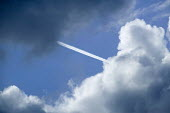 Airplane vapour trails as storm clouds gather. - Paul Box - 05-12-2005