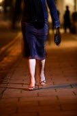 A woman walks at night. - Paul Box - 05-12-2005